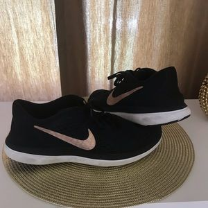Nike athletic black and gold sneakers